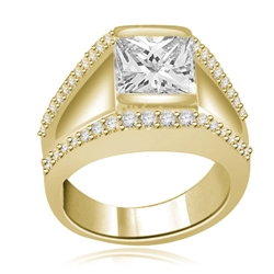 A unique contemporary Ring featuring a channel set 2 Ct. Princess Cut Diamond Essence Masterpiece with a melee of Round Cut accents. Thoroughly impressive 2.75 Cts.T.W. in 14K Solid Gold.
