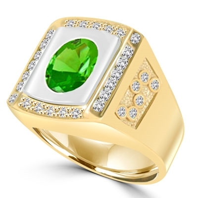 An impressive Men's Ring in two-toned 14K Solid Yellow Gold features a 4.0 cts. Oval Emerald stone set flush in a platform of white gold surrounded by melee, with double jolts of melee on each shank. 4.50 cts. t.w.