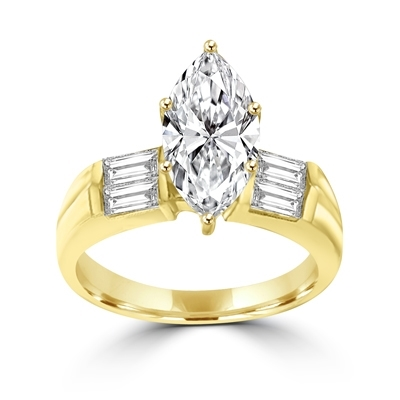 A dazzling one-carat marquise-cut Diamond Essence gem with bold baguettes. 1.5 cts. t.w., in 14K Solid Gold.