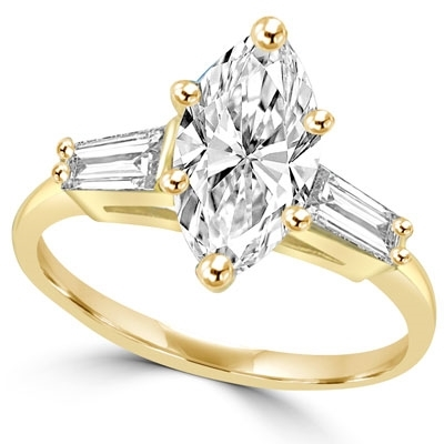 Ring with 1 carat marquise cut stone in middle and baguettes on each side
