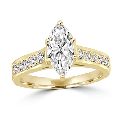 Classic Ring with a 1 Ct. Marquise Cut Diamond Essence Masterpiece in the center and an inriguing Melee of Channel Set Masterpieces down the band. 1.3 Cts. T.W. in 14K Solid Gold.