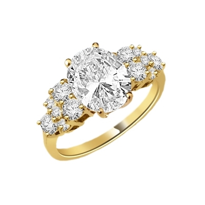 Designer Ring featuring a carefree display of 3.0 Cts. Oval Cut Diamond Essence Center with the irresistible touch off six Round Brilliant Cut Masterpieces flashing temptingly on each side. 4.50 Cts. T.W. in 14K Solid Yellow Gold.