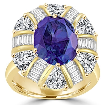 Ring – sapphire stone,baguettes and trillion cut stones around it