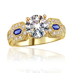 Impressive ring, its 2.0 ct. round cut Diamond Essence diamond set off by lozenge-shaped Sapphire Essence stones embedded with melee. 2.30 cts. w.t. in 14K Solid Gold.