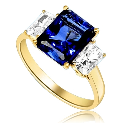 Sapphire Ring - 4.0 Cts. Radiant Emerald cut Saphhire Essence in center accompanied by Radiant Emerald cut Diamond Essence on sides. 5.0 Cts. T.W. set in 14K Solid Yellow Gold.