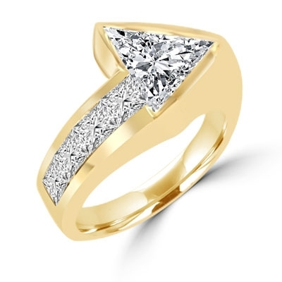 Meet the Star! Graduating Diamond Essence Brilliants ascend to kiss the beauty of shining 4 Cts. Trilliant set exquisitely on channels forming a design to behold. 4.75 Cts. T.W. set in 14K Solid Yellow Gold.