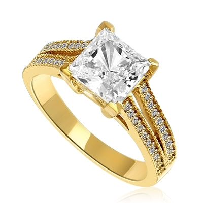 Diamond Essence Ring with Princess in Center accompanied by two rows of melee on each side. 3.25 Cts T.W. set in 14 K solid Yellow Gold.