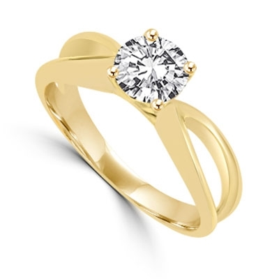 This Ring Is a sureshot hit with jewelry conossieurs. 0.75 Ct. Round Brilliant Masterpiece is set exquisitely on a cross curve band. In 14k Solid Yellow Gold.