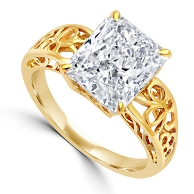 In this finely created ring, a 4 Ct. Radiant Emerald White Brilliant Stone is crafted atop an ethic set wide band. In 14k Solid Yellow Gold.