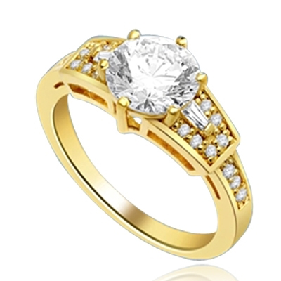 Mesmerizing 2.0 Ct Brilliant stone is adorned by superbly crafted Baguettes and Round Melee forming 2.5 Cts. T.W. In 14k Solid Yellow Gold.