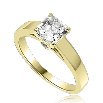 Diamond Essence Asscher cut Solitaire Ring artistically set in a wide band with a beautiful accent on both sides to enhance the looks. 1 ct.t.w. in 14K Solid Yellow Gold.