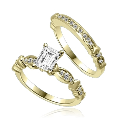 Beautiful Wedding Set with 1.0 Ct. Emerald cut Emerald Essence set in center accompanied by Melee on either side and on the matching band. 1.50 Cts. T.W. set in 14K Solid Yellow Gold.