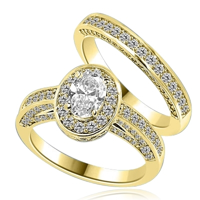 Wedding Set--1.0 ct. Oval cut Diamond Essence set in the center with melee around. Matching band with Melee. 2.50 cts.t.w.in 14K Solid Yellow Gold.