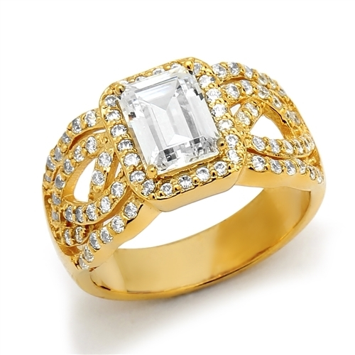 Diamond Essence Designer Ring With 1.50 Cts. Emerald Cut Diamond Essence Center Surrounded By Melee And Exquisitely Set Round Brilliant Melee On Both The Sides Of Band, 2.50 Cts.T.W., in 14K Solid Gold.
