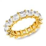 Diamond Essence Eternity Band With French Cut Stones, Approx 4 Cts.T.W. In 14K Yellow Gold.