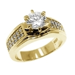 Diamond Essence Ring With 1 Ct. Round Brilliant Center Set in Six Prong Setting and Sparkling Melee on The Band Enhance the look in 14K Yellow Gold,1.25 Cts.T.W.
