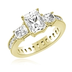 Diamond Essence Ring with Radient Emerald Center Followed by Princess cut Stones And Round Brilliant Melee on the band, 4.50 Cts.T.W. set in 14K Yellow Gold.