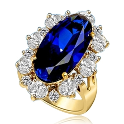 Sapphire Ring - 13 Cts. Long Oval cut Sapphire Essence set in center surrounded by Oval Diamond Essence and Melee. 16.0 Cts. T.W. set in 14K Solid Yellow Gold.