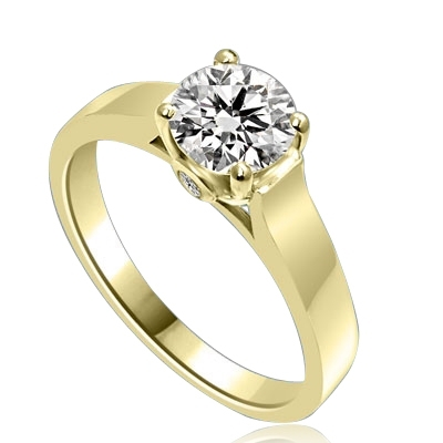 Diamond Essence Solitaire Ring Artistically set in wide band with a beautiful accent  on both sides to enhance the looks set in 14K Solid Yellow Gold.