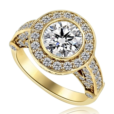 Designer Ring with Bezel Set, 2.0 Cts. Round Brilliant Diamond Essence in center with Melee around and on the band, 2.5 Cts. T.W. set in 14K Yellow Gold.
