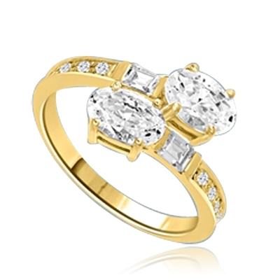 Two  Oval Essence, 1.0 ct. each, set in four prongs and accompanied by baguettes and melee on band. 2.5 Cts. T.w. In 14k Solid Yellow Gold.