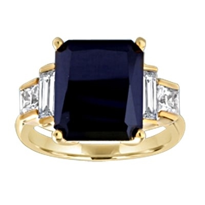 Onyx Ring - 6.0 Cts. Radiant Emerald cut Onyx Essence set in four prongs, accompanied by channel set Diamond Essence Baguettes and Princess cut stones on either side. 7.0 Cts.T.W. set in 14K Solid Yellow Gold.