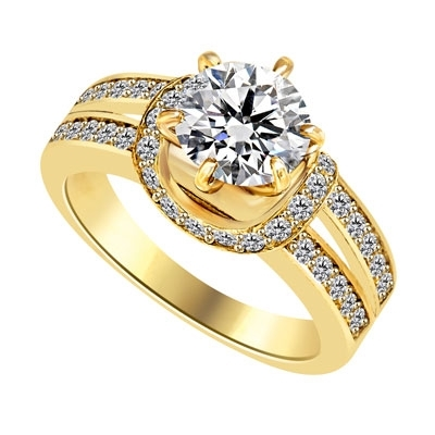 Engagement Ring- 1.75 Cts. Tiffany set Round Brilliant Diamond Essence in center enhanced by melee in curvd setting and two rows of melee on each side, adding more sparkles. 2.25 Cts T.W. set in 14K Solid Yellow Gold.