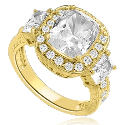 A 4 Ct Sparkling Ring with Radiant Emerald Cut is adorned by Brilliance on all sides of Round Accents and smaller Radiant Emerald on band. A stupendous 6.5 Cts. T.W. In 14k Solid Yellow Gold.