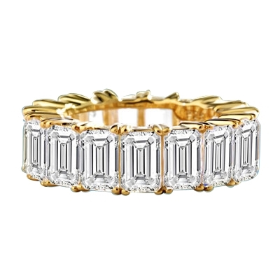 Diamond Essence Best selling eternity band with all round sparkle of emerald cut brilliant stones. 9 Cts. T.W. set in 14K Solid Yellow Gold.