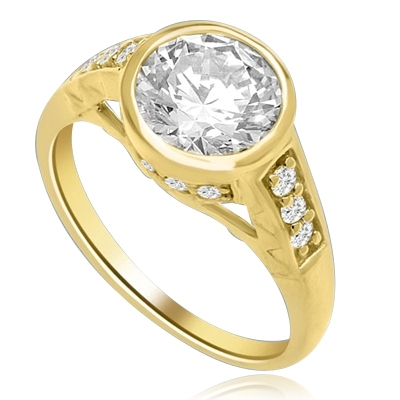 Bezel Set Ring Boasts of 2 Ct Round Solitaire in a unique contemporary band with round accent melee. A sheer beauty! 3 Cts. T.W. In 14k Solid Yellow Gold.