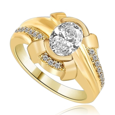 1.25 Cts. Chanel set Oval cut Diamond Essence in center with Melee on top and bottom flowing down on band, 1.50 Cts. T.W. set in 14K Solid Yellow Gold.