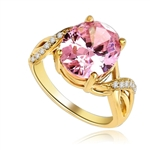 Diamond Essence Designer Ring with 5.0 Cts. Pink Oval  in center, accompanied by melee on band, 5.65 Cts.T.W. set in 14K Solid Yellow Gold.