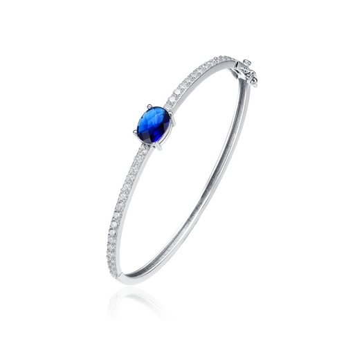 Bangle Bracelet - 2.0 Cts.Oval cut Sapphire Essence set in center with sparkling Diamond Essence Melee going around the Bangle, 4.0 Cts.T.W. set in Platinum Plated Sterling Silver.