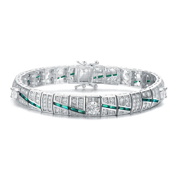 "A stunner, this Platinum Plated Sterling Silver 7.25"" bracelet features five round brilliant stones, 0.5 cts each, joined by melee and emerald baguettes . 14.0 cts. T.W."