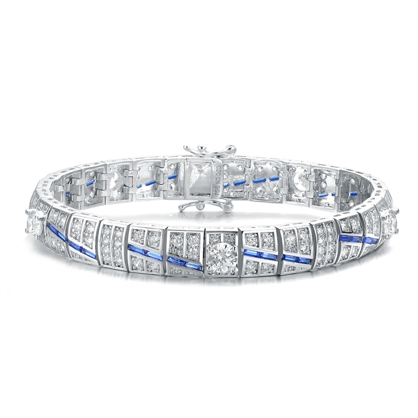 "A stunner, this Platinum Plated Sterling Silver 7.25"" bracelet features five round brilliant stones, 0.5 cts each, joined by melee and sapphire baguettes . 14.0 cts. T.W."