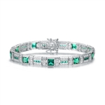 "A stunner, this Platinum Plated Sterling Silver 7.25"" bracelet features nine princess emerald stones, 0.25 cts each, joined by melee. 17.0 cts. T.W."