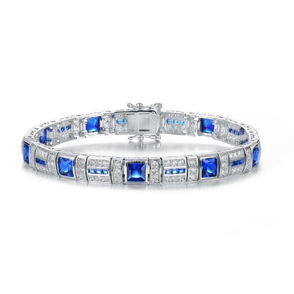 "A stunner, this Platinum Plated Sterling Silver 7.25"" bracelet features nine princess sapphire stones, 0.25 cts each, joined by melee. 17.0 cts. T.W."