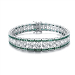 "A stunner, this Platinum Plated Sterling Silver 7.25"" bracelet features graduating round brilliant stones, emerald baguettes at the top and the bottom. 30.0 cts. t.w."