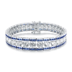 "A stunner, this Platinum Plated Sterling Silver 7.25"" bracelet features graduating round brilliant stones, sapphire baguettes at the top and the bottom. 30.0 cts. t.w."