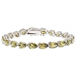 A beautiful bracelet, showing off 21 pear shape Diamond Essence Peridot stones, 0.75 ct. each, set in Platinum Plated Sterling Silver. 15.75 cts.t.w.