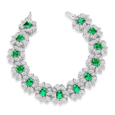 "7"" long Diamond Essence Bracelet with Emerald cut 13 Emerald Essence,each 1ct, surrounded by Marquie, Pear and Round stones. Appx. 38.0 Cts. T.W. set in platinum Plated Sterling Silver."