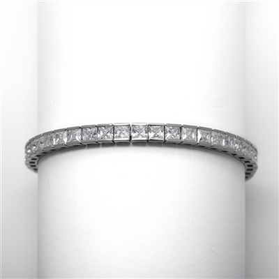 Platinum Plated Sterling Silver tennis bracelet strung with 43 princess cut masterpieces in a mesmerizing array, with double safety clasp, 12.0 cts. T.W.