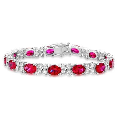 "7"" long Diamond Essence Designer Bracelet with 1.25 Cts. each Oval cut Ruby Essence and Round Diamond Essence Stones. Appx. 27.0 Cts. T.W. set in Platinum Plated Sterling Silver."