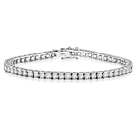 Diamond Essence classic bracelet, showing off appx. 6.0 cts. round briliiant stones set in tension bar setting of Platinum Plated Sterling Silver.