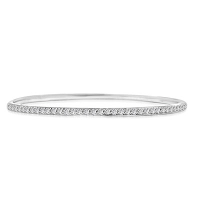 An alluring prong-set slip-on bangle bracelet for women with simulated round brilliant Diamonds by Diamond Essence set in platinum plated sterling silver. 4.50 Cts.t.w.