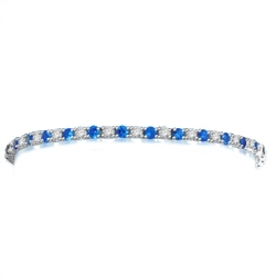 "Diamond Essence Sapphire-and-Diamond Tennis Bracelet--7"" tennis bracelet alternates round-cut Sapphire Essence and Diamond Essence jewels.5.0 Cts. T.W. set in Platinum Plated Sterling Silver."