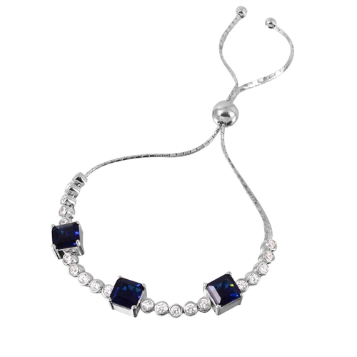Diamond Essence Adjustable Bracelet with 1.0 ct. each Sapphire Princess cut stone in prong setting and 0.20 ct. each Round Brilliant stone in bezel setting. Beautiful bracelet  to fit on any size wrist. 8.0 Cts.T.W. in Platinum Plated Sterling Silver.