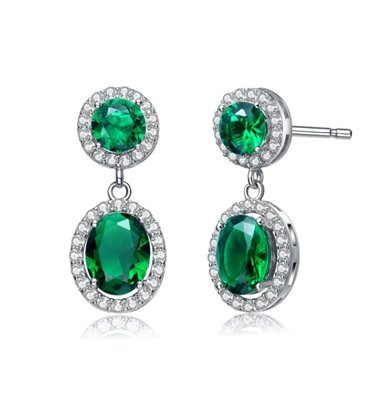 Emerald Essence 0.5 Ct. Round stones and 2.0 Cts. Oval cut stones, set in four prongs settings and surrounded by Diamond Essence Melee. Looks very attractive. 6.50 Cts.T.W. set in Platinum Plated Sterling Silver.
