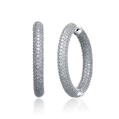 "In and Out hoop earrings,artistically crafted in Platinum Plated Sterling Silver with special press on lock. Diamond Essence melee set in prongs for classic sparkle. 9.0 cts.t.w. ( 1 &1/2"")."