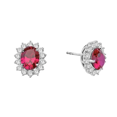 Designer Oval studs with 2.50 Cts. Ruby in center, surrounded by 14 Round Brilliant Diamond Essence Stones Appx. 6.0 Cts. T.W. set in Platinum Plated Sterling Silver.
